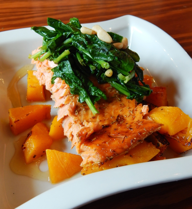 Honey Drizzled Salmon on a bed of Butternut Topped w/ Spinach