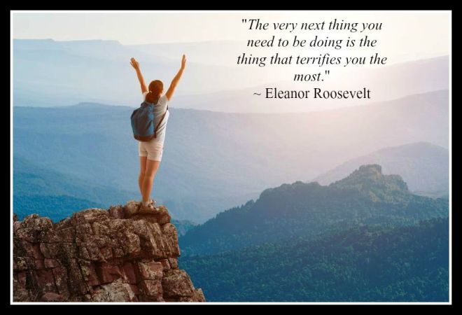 woman on mountain top with quote