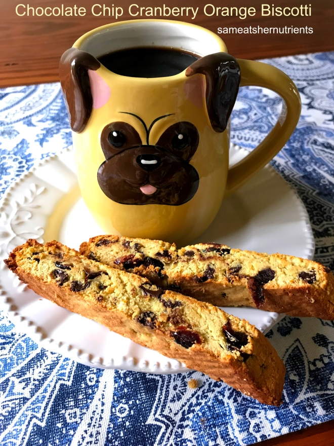 Chocolate Chip Cranberry Orange Biscotti On a Plate with a Pug Mug - Grain Free